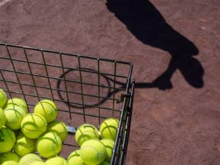 silhouette of a tennis player and tennis balls